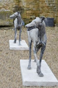 A pair of French lead greyhounds, circa 1900