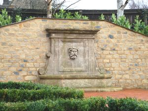 Filler: The Neptune Wall Fountain with Stone Mask - Hand Carved Natural Limestone