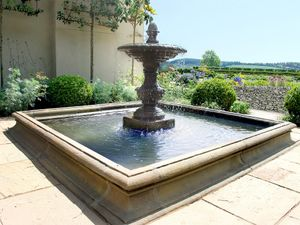 Filler: The Single Tier Fountain in Square Pool Surround