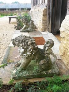 Filler: Pair of Antique Bath Stone Dogs