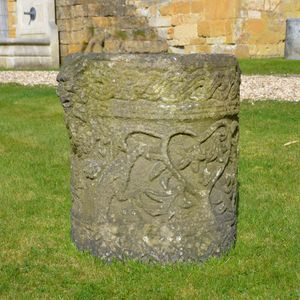 A Romanesque style mortar, now planter