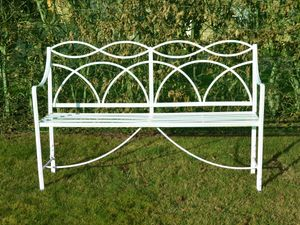 A Regency wrought iron garden seat