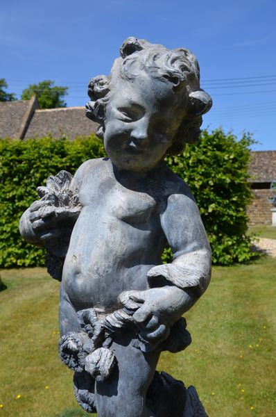 An early 20th century lead figure depicting Summer