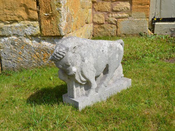A Portland stone sculpture of a bull (Taurus) by Roy Smith RWA