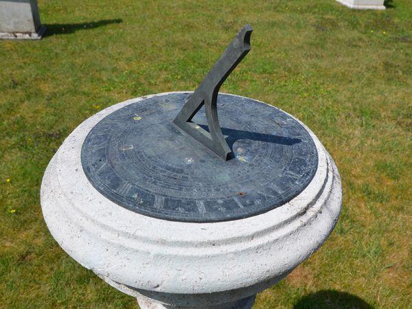 A Portland stone sundial pedestal with Negretti and Zambra dial Plate
