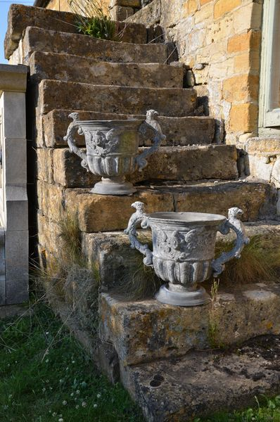 A pair of 18th century lead urns