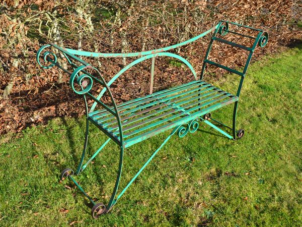 A vintage painted iron strapwork garden seat