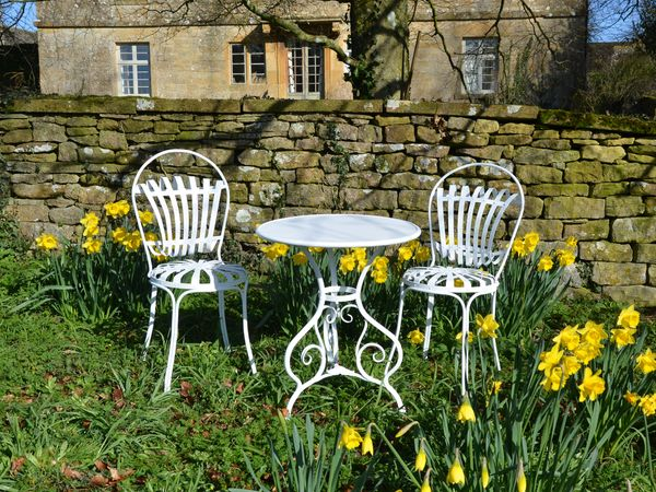 The Circular Garden Table for Two with Two Sprung Garden Chairs