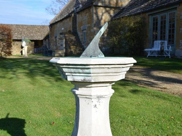 An 18th century Portland stone sundial pedestal with brass dial plate by Thomas Wright  (1711-1786)
