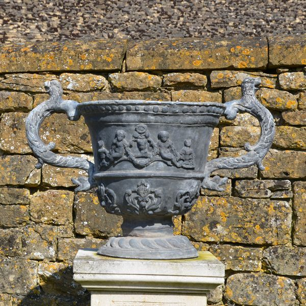 A large pair of lead urns