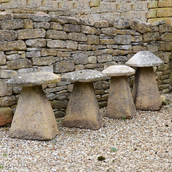 A group of four Cotswold stone staddlestones