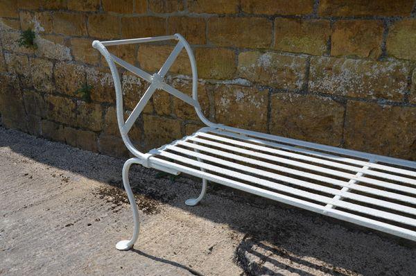 A vintage wrought iron garden bench