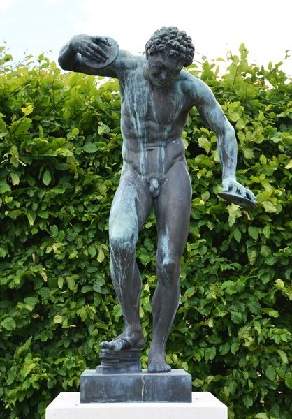 A pair of Italian 19th century bronze statues of The Dancing Faun and The Apollino after the antique