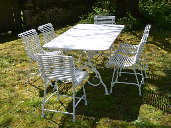 The Small Rectangular Garden Dining Table for Six with Six Ladderback Chairs