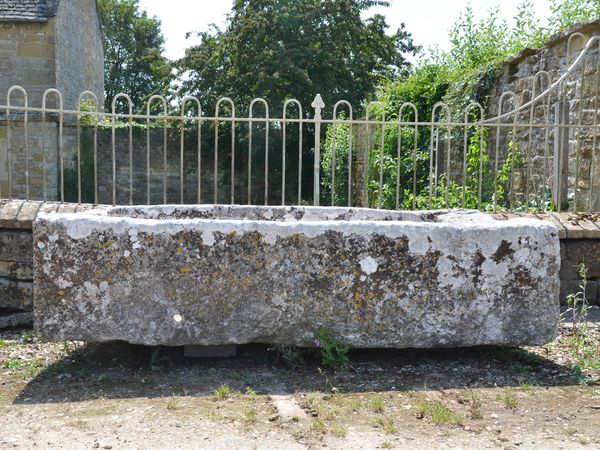 A large 18th century stone trough