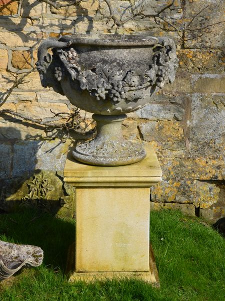 A pair of Austin & Seeley artificial stone urns known as the 'Adelaide Vase'