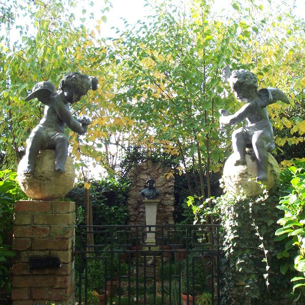 The Winged Lead Putti Finials