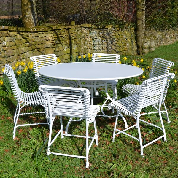 The Large Circular Garden Dining Table for Six with Six Ladderback Chairs