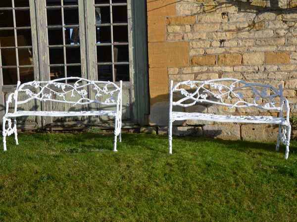 A 19th century cast iron garden seat of a twig and foliage design