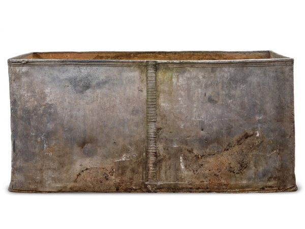 A 18th century lead cistern dated 1714