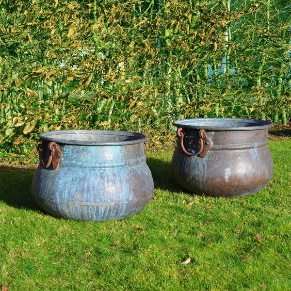 A pair of vintage copper cauldron garden planters