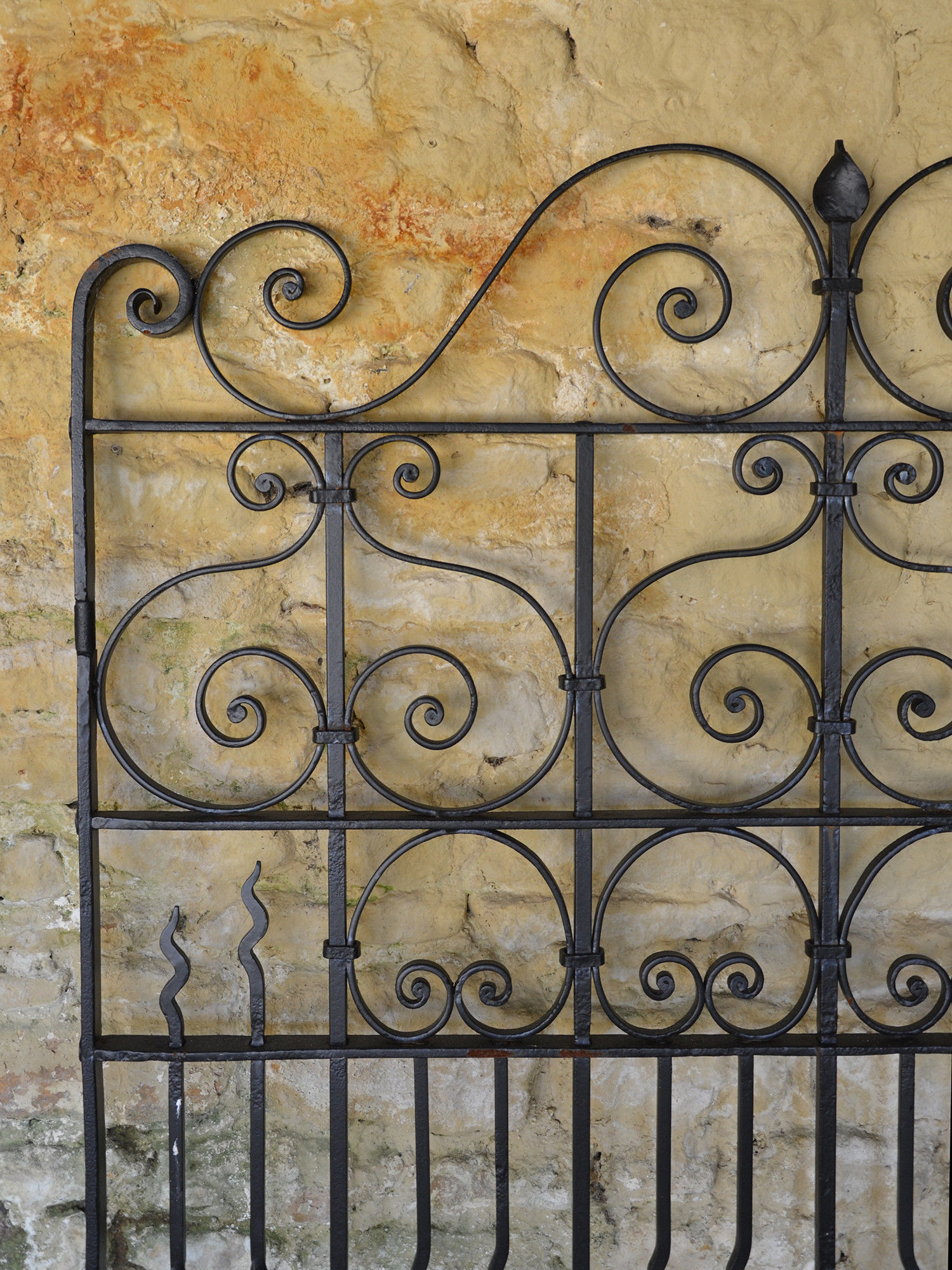 A large single wrought iron garden gate