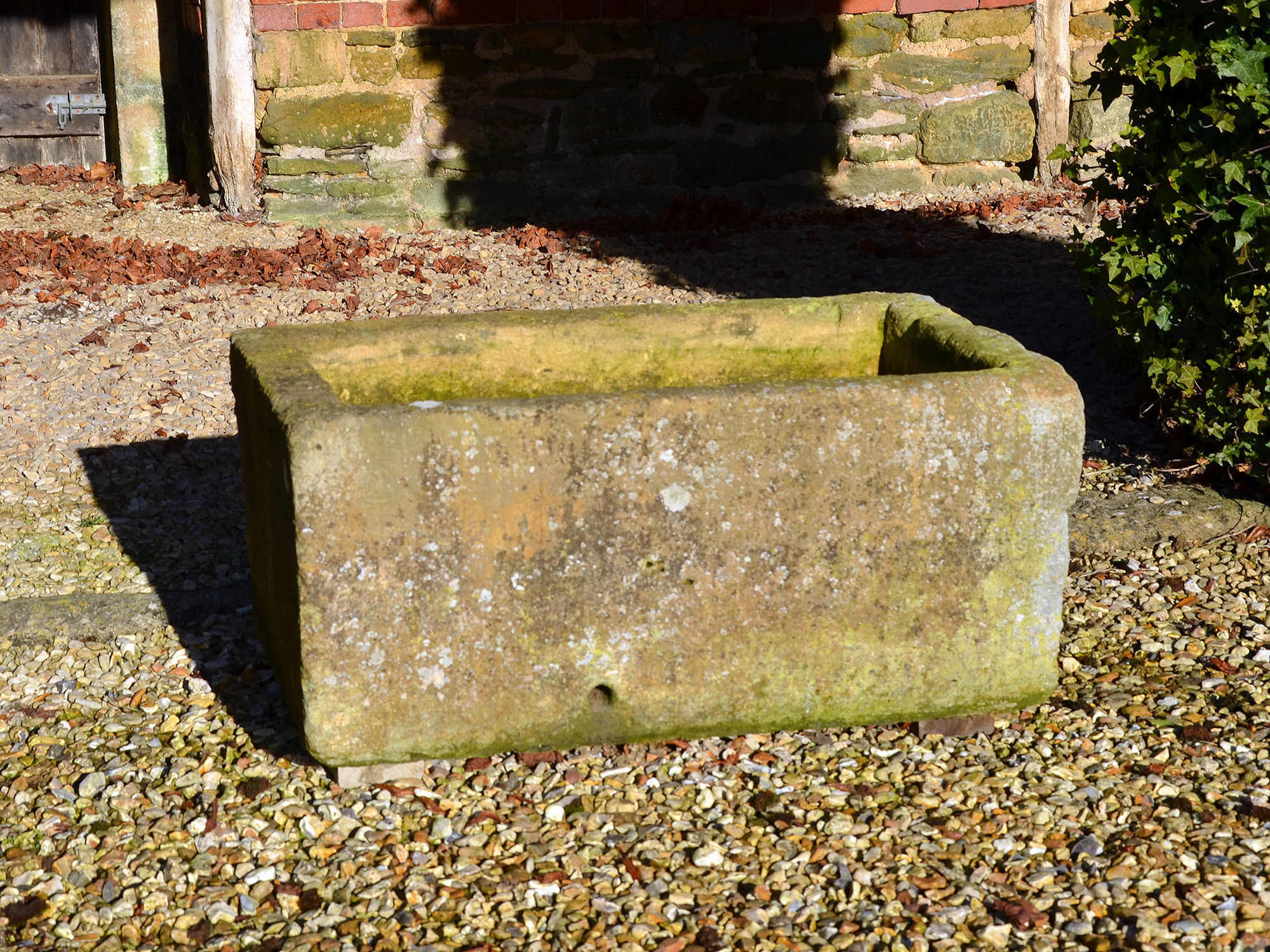 A 19th century carved Cotswold stone trough