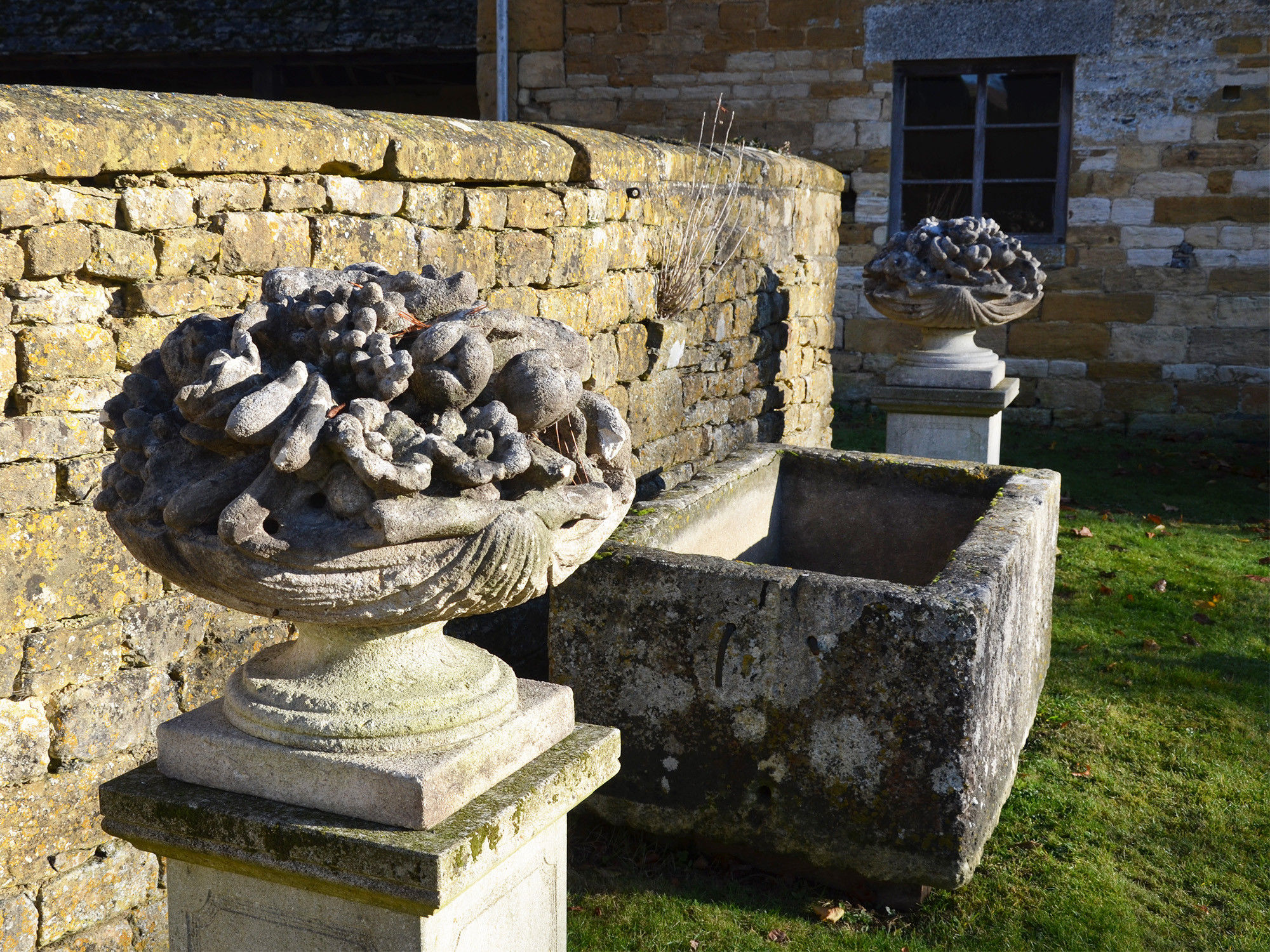 A pair of mid-20th century Italian limestone fruit basket finials