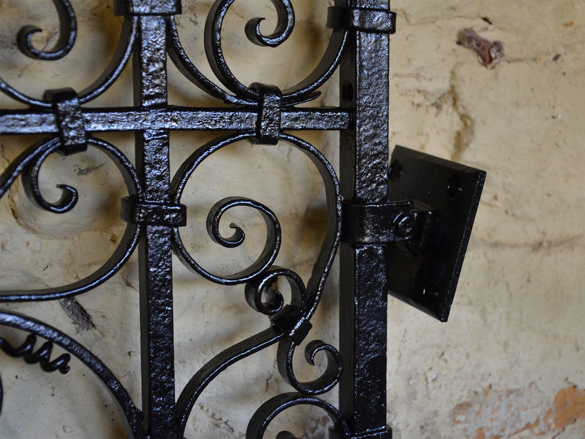 A pair of small early 20th century decorative wrought iron garden gates