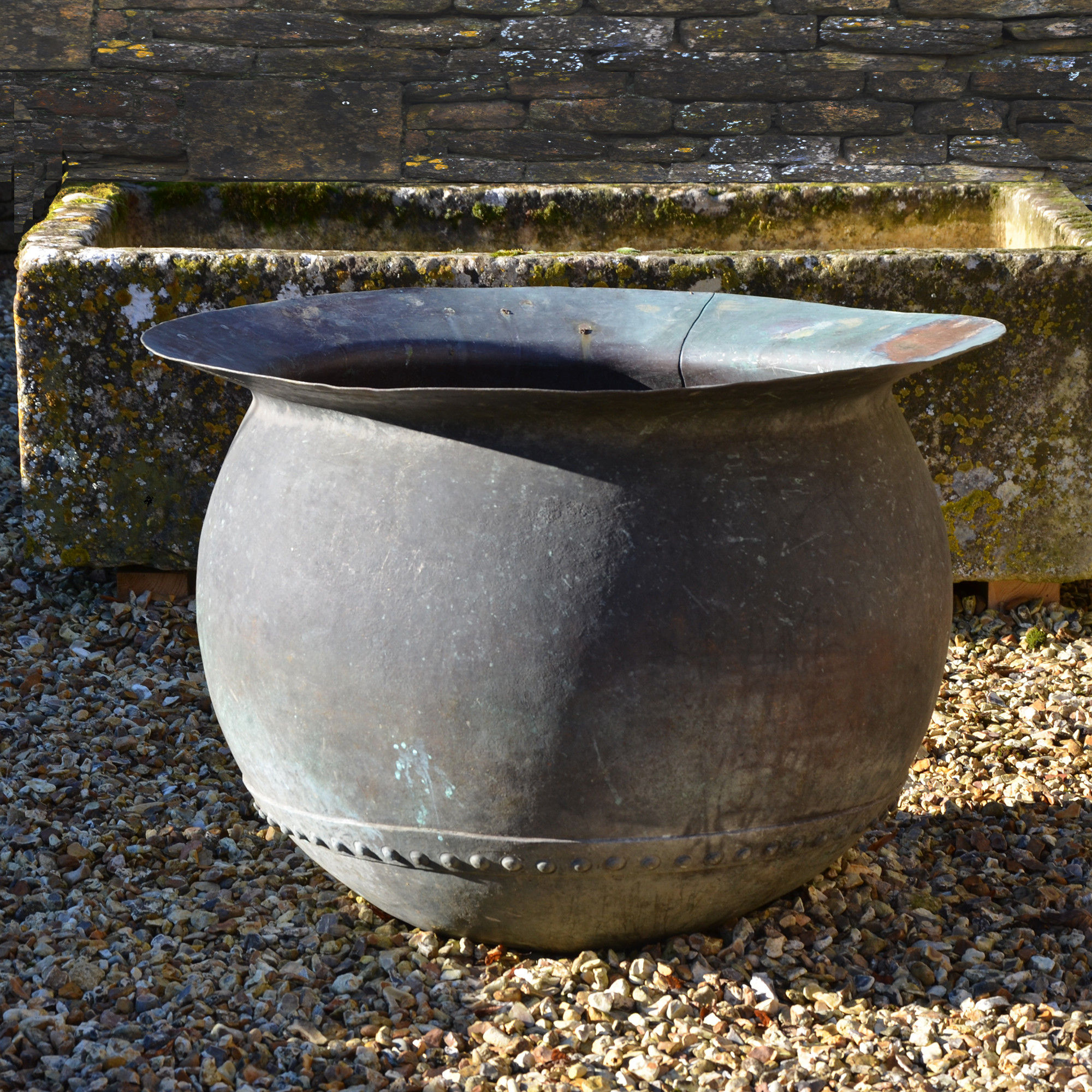 A first stage copper 'tanners cauldron' of bulbous form with wide flat rim