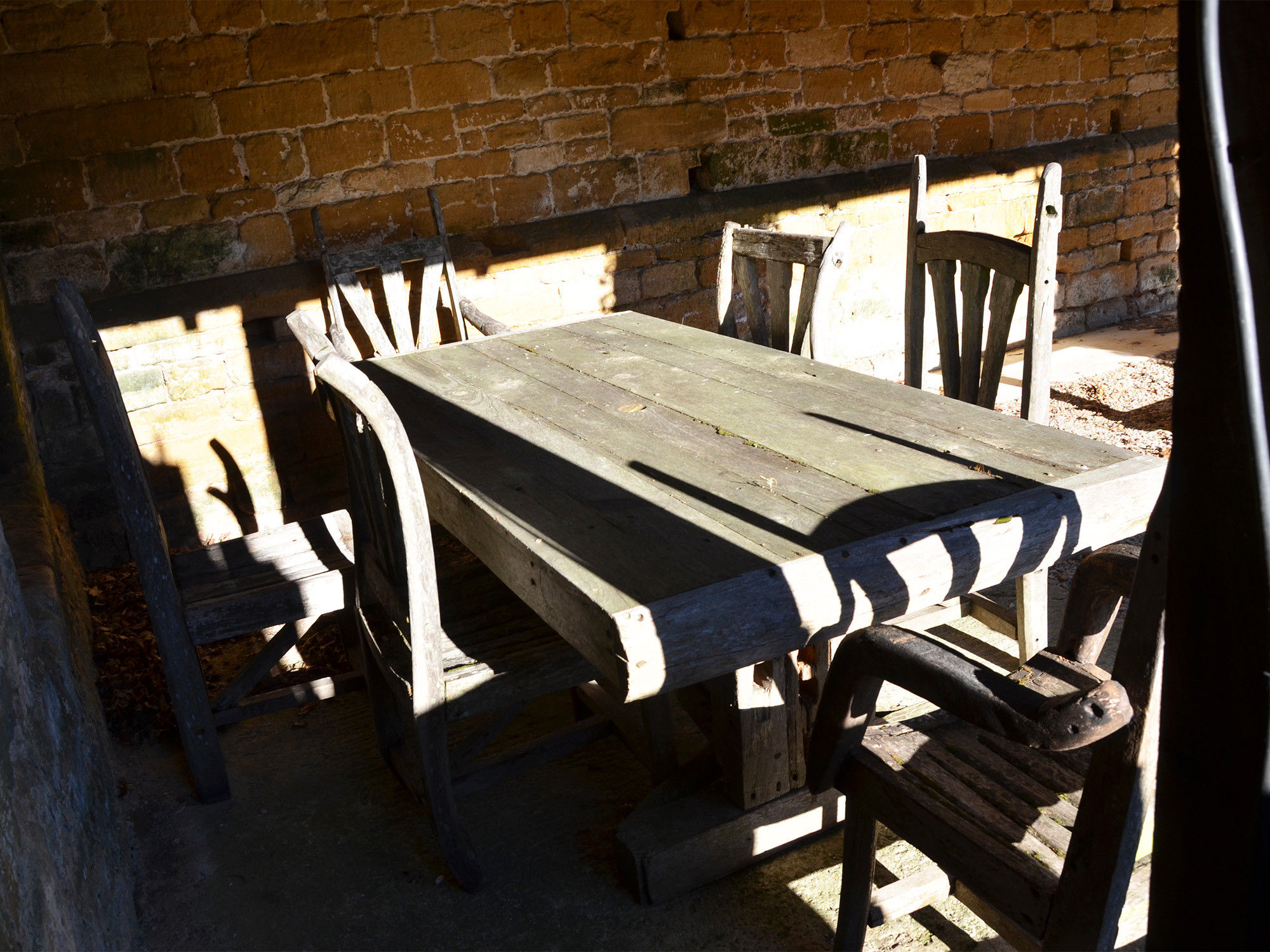 A 20th century rustic hardwood table and six chairs