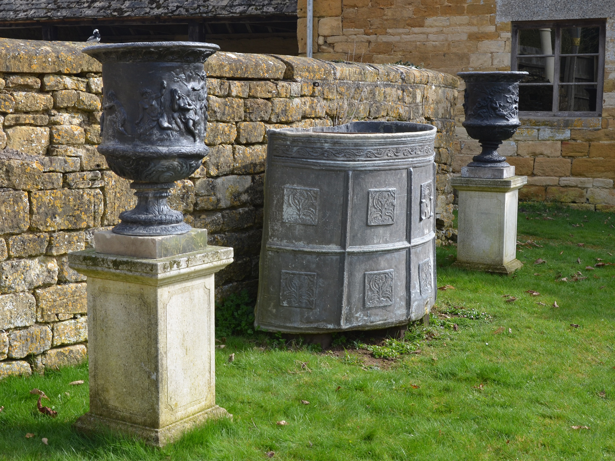 A large pair of 19th century lead urns