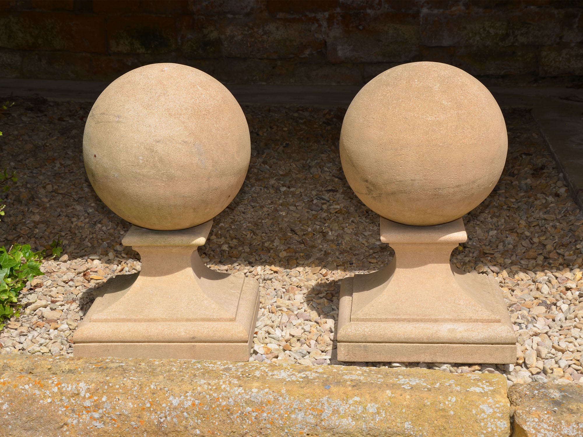 A pair of Bath stone ball finials