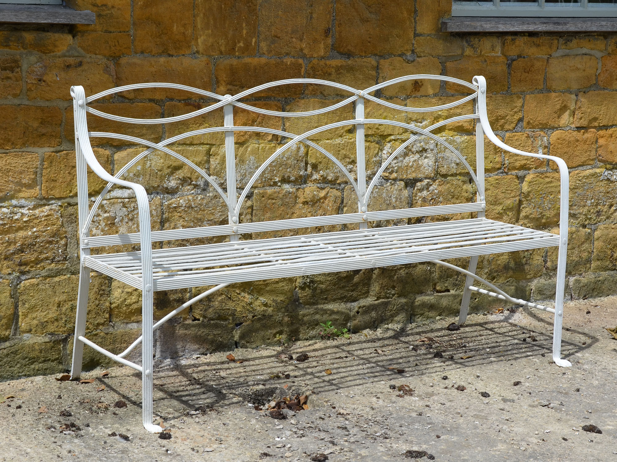 A wrought iron Regency garden seat