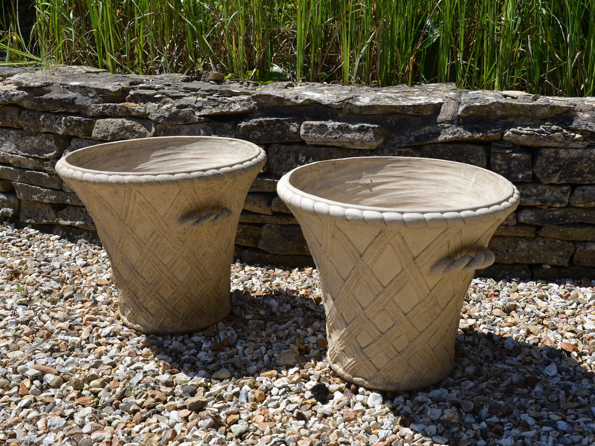 A pair of 20th century terracotta garden planters by Philip Thomason