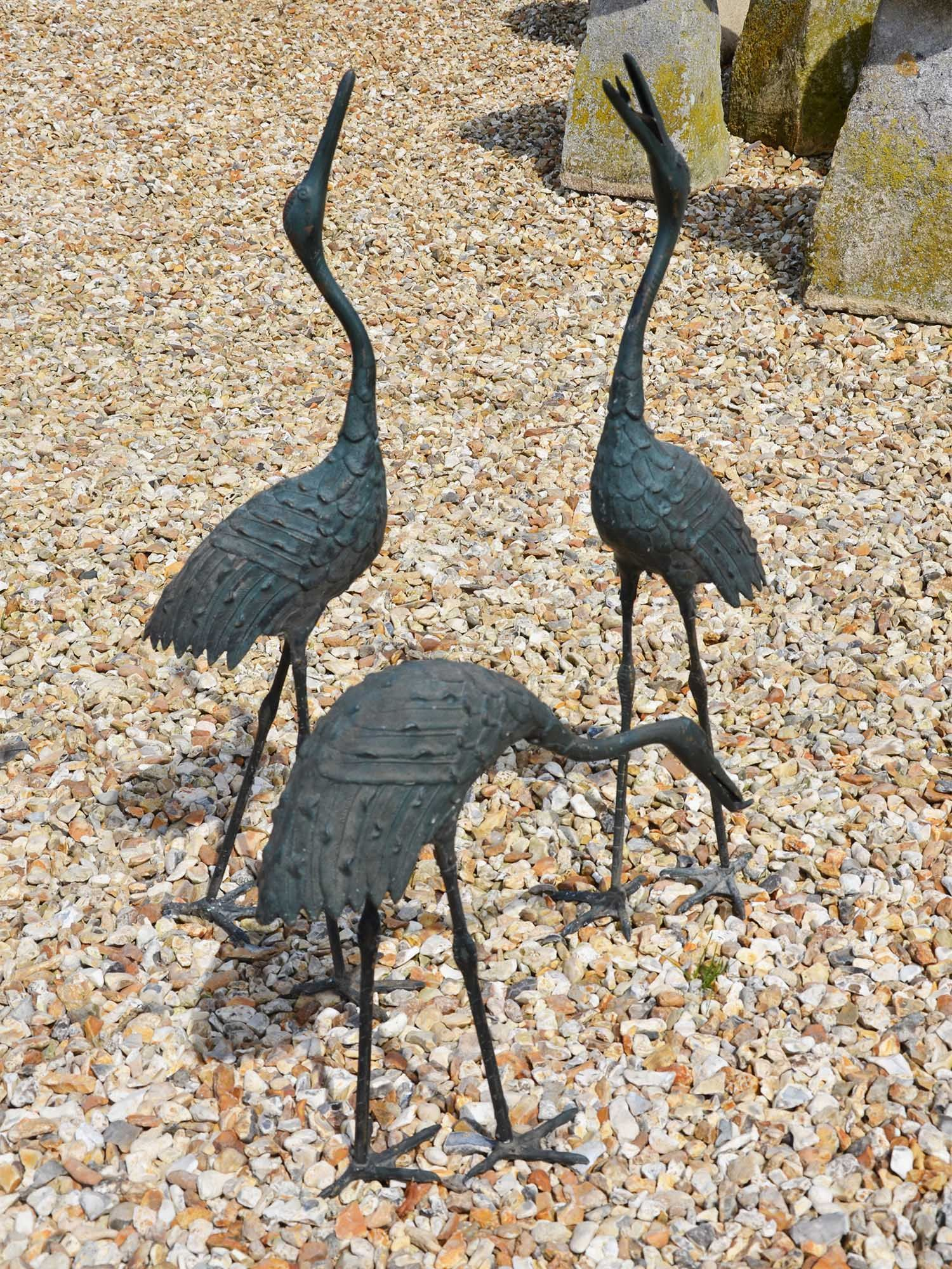 A set of three Taisho period (1912-1926) Japanese bronze cranes