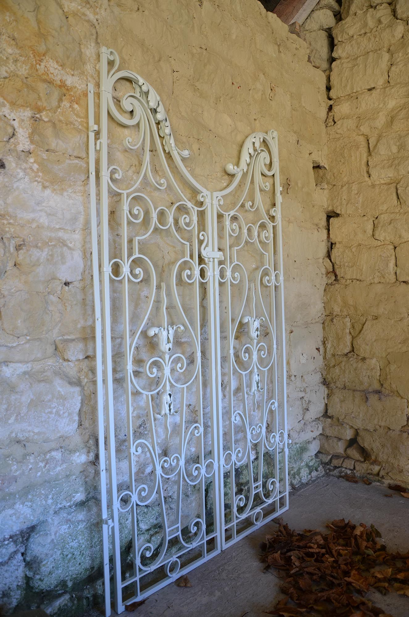A pair of wrought iron garden gates in the Rococo taste