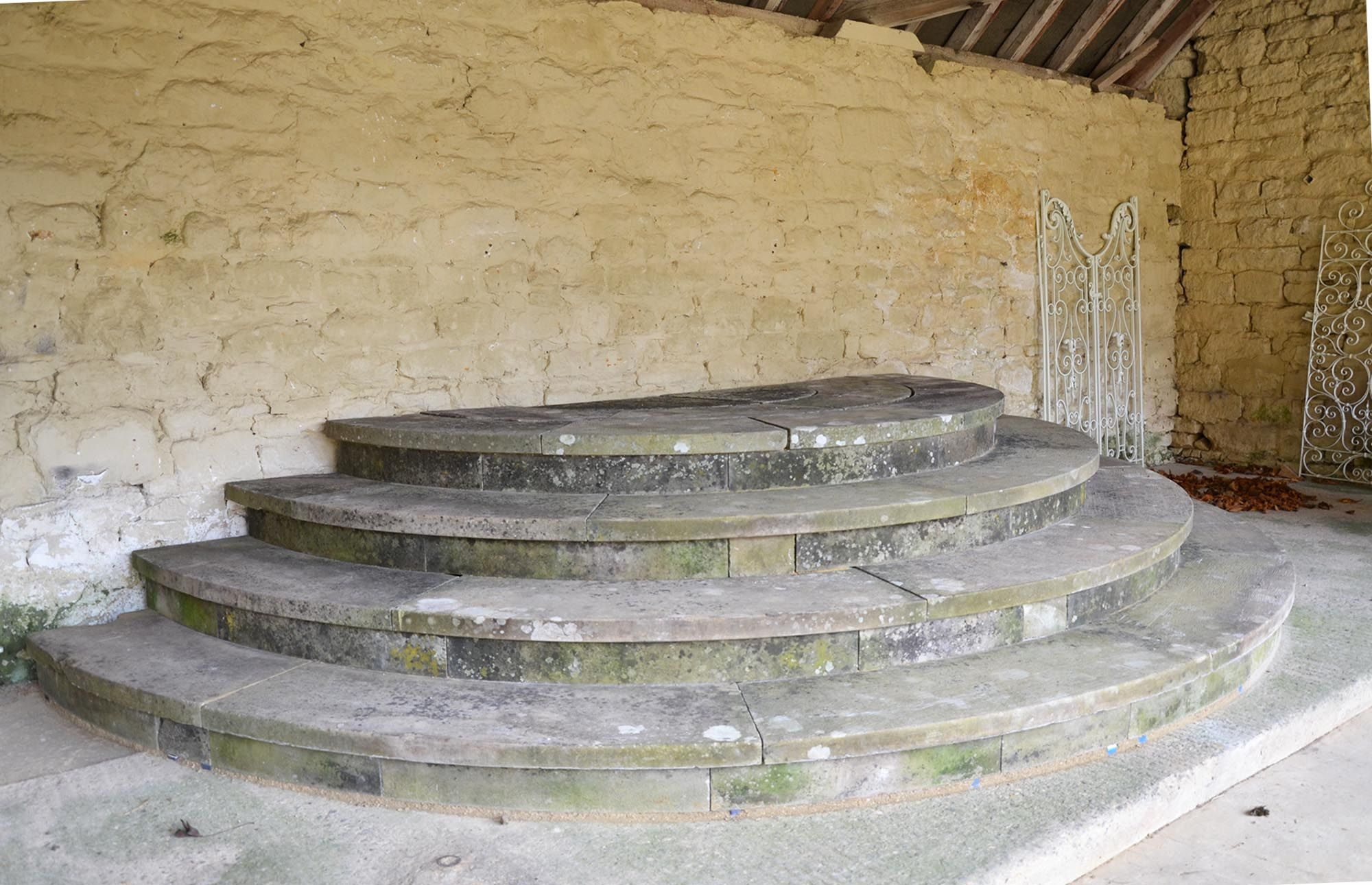 A suite of York stone steps of semi-circular form