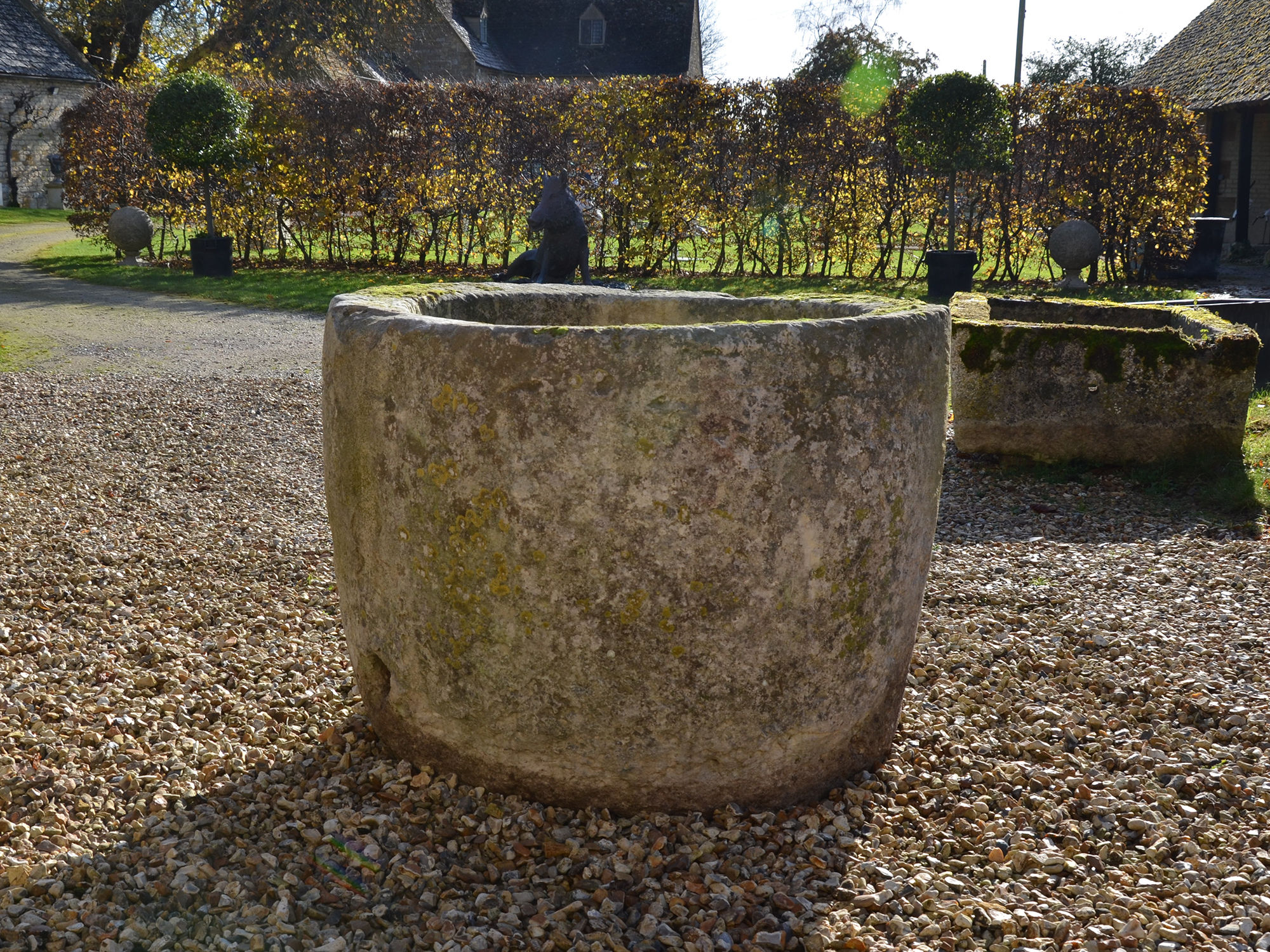 A large 18th century circular stone trough
