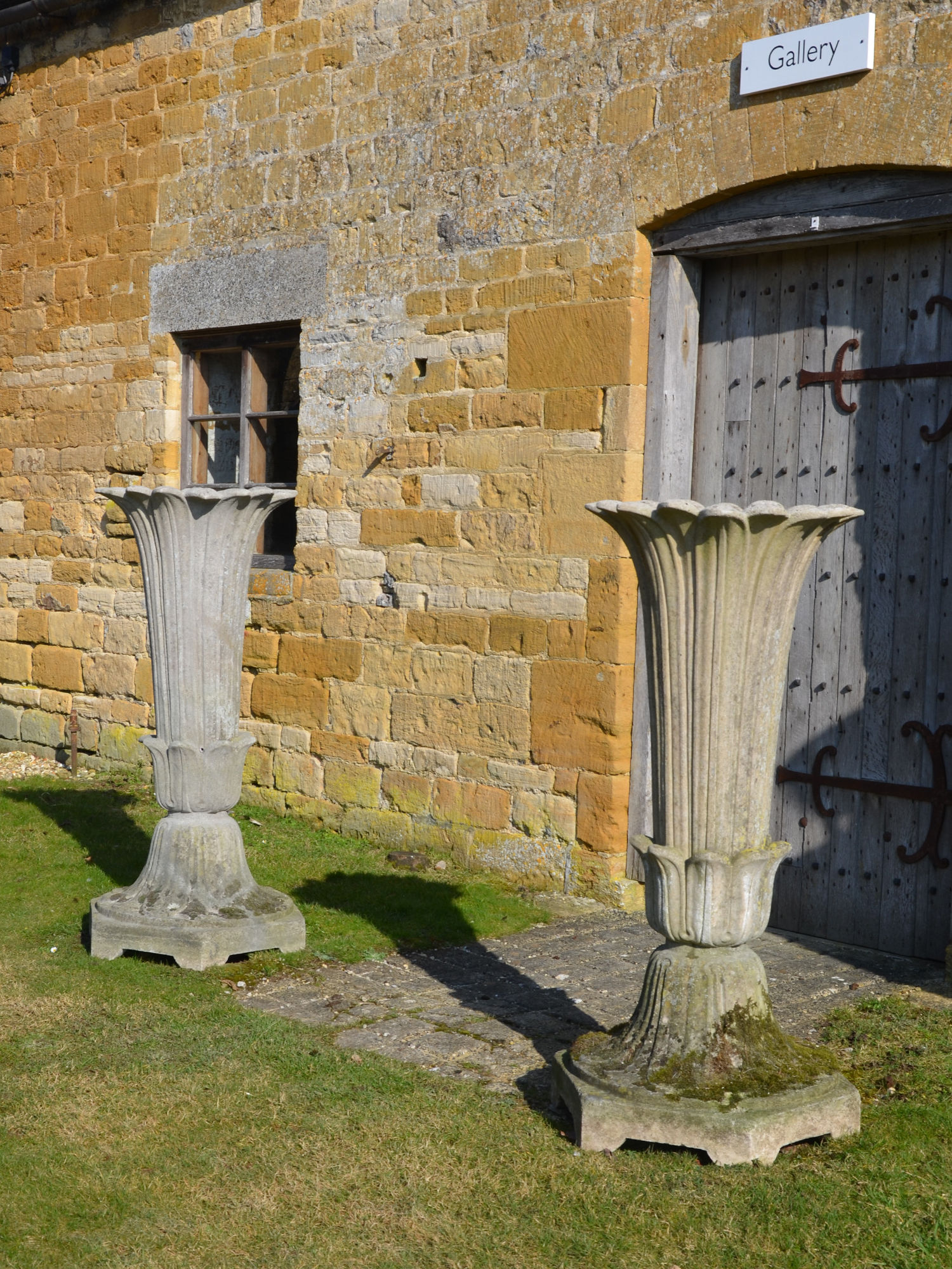 A pair of mid 19th Century composition stone garden vases by Austin and Seeley