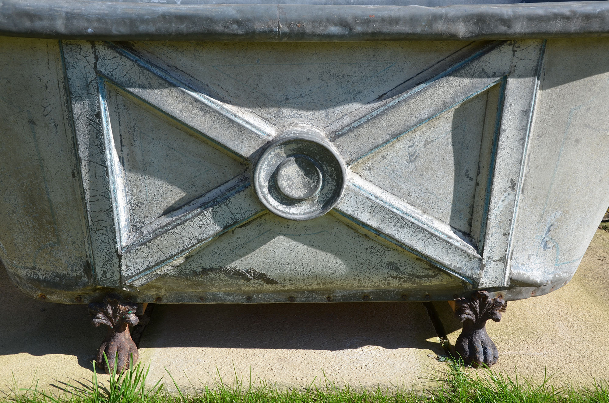 A 19th century painted zinc bath tub