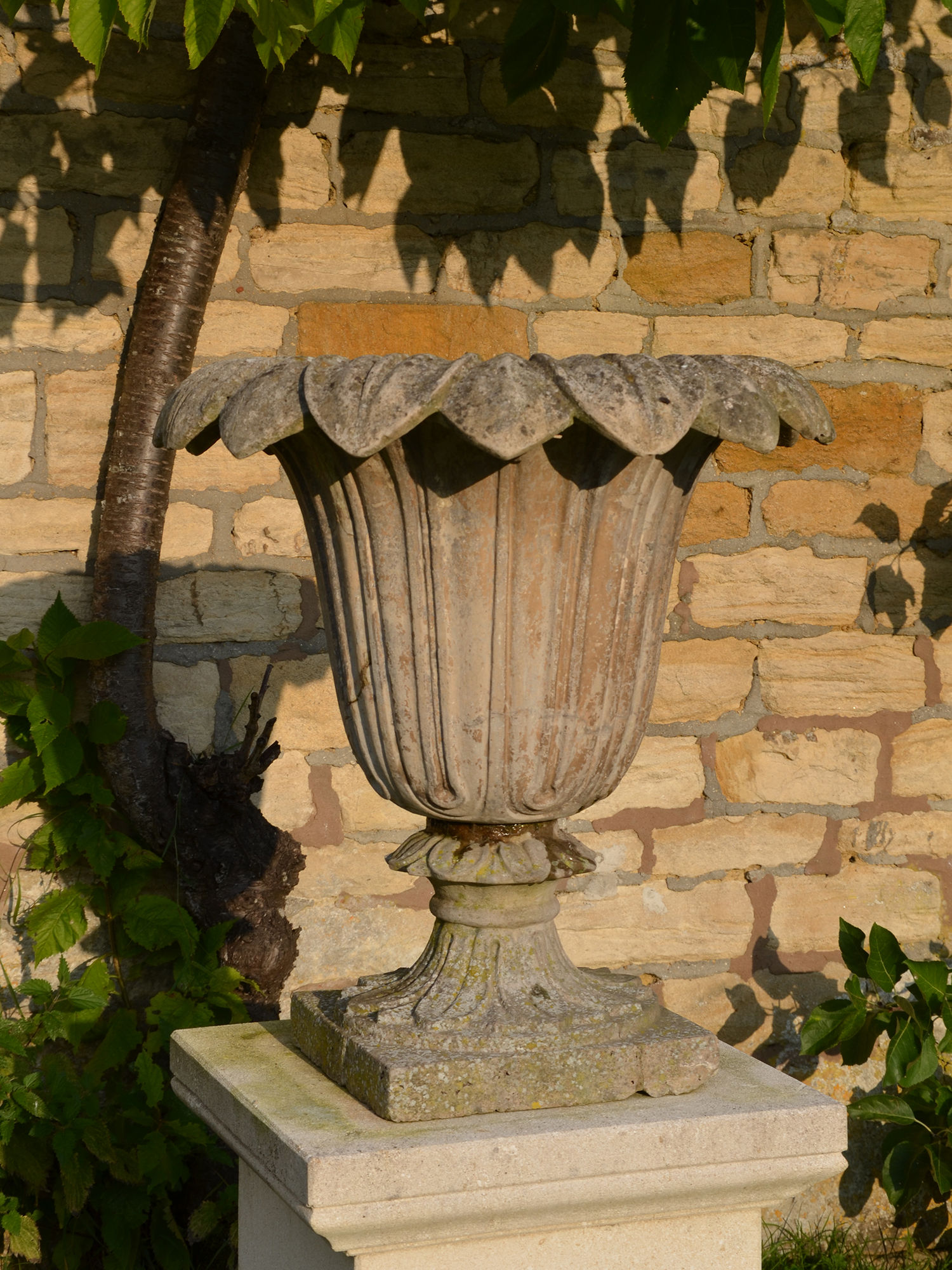 A pair of Austin and Seeley composition stone urns