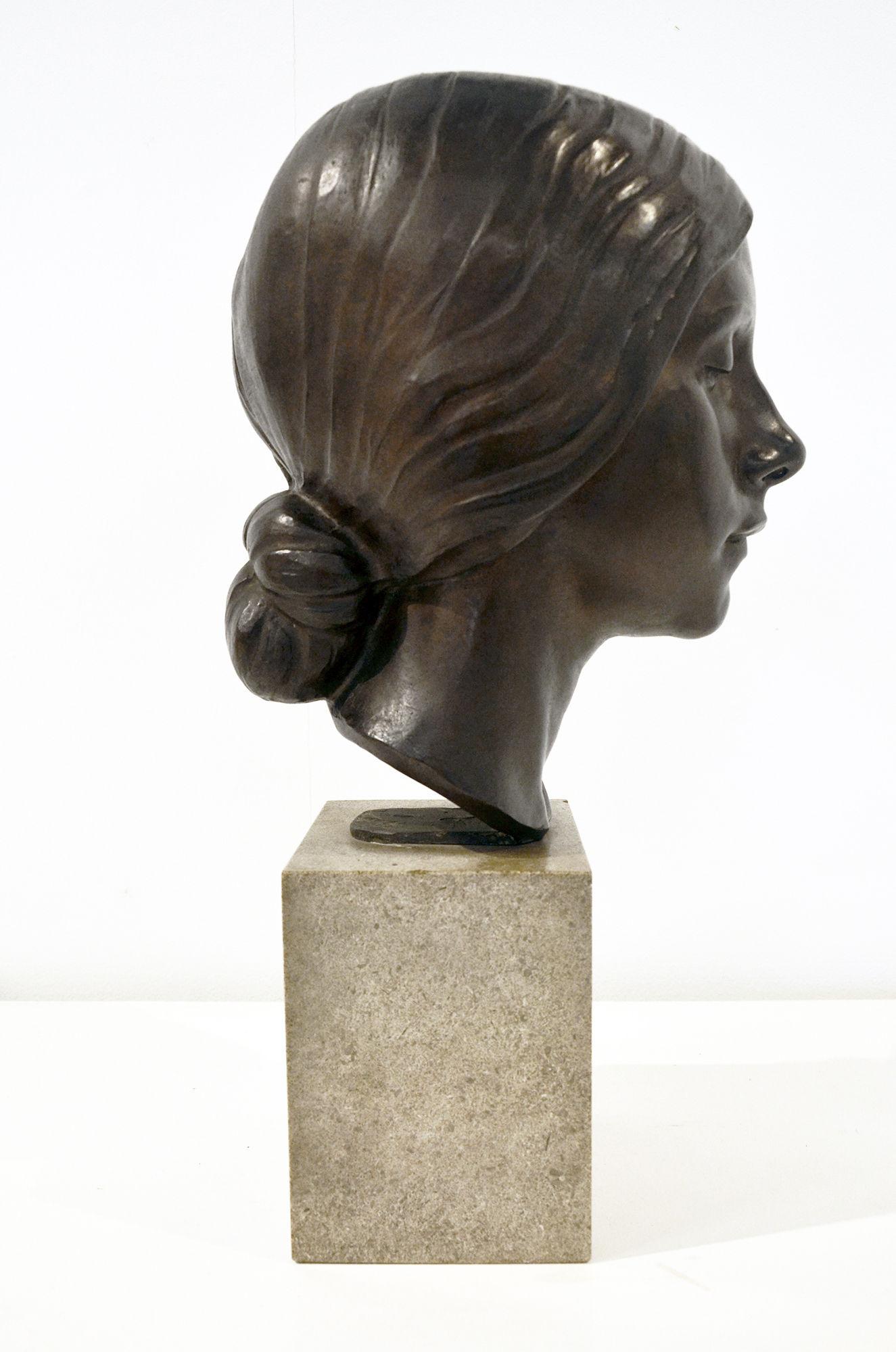 A bronze portrait bust of a young women by Herbert Palliser 1883-1963