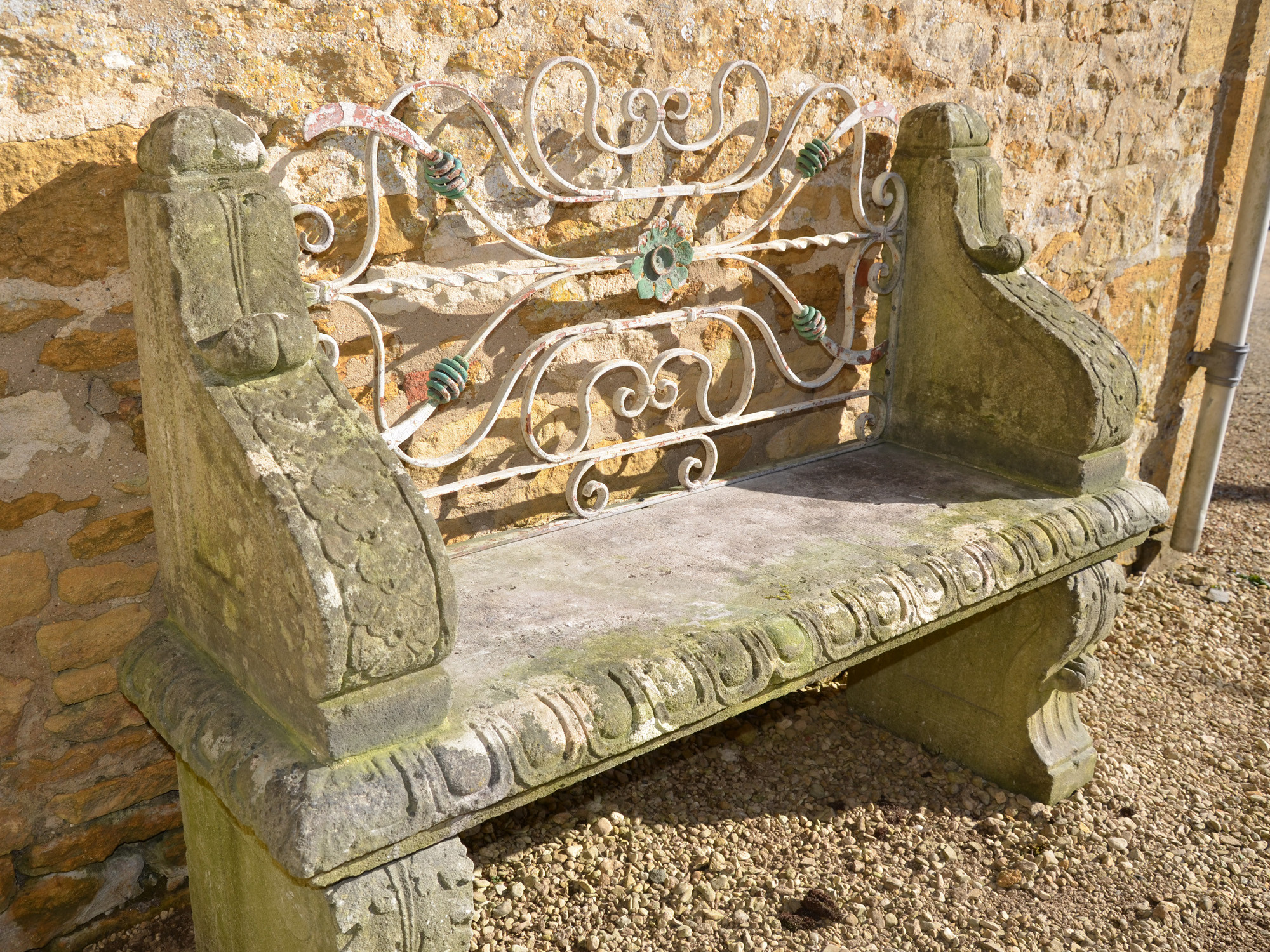 An early 20th century carved limestone garden seat