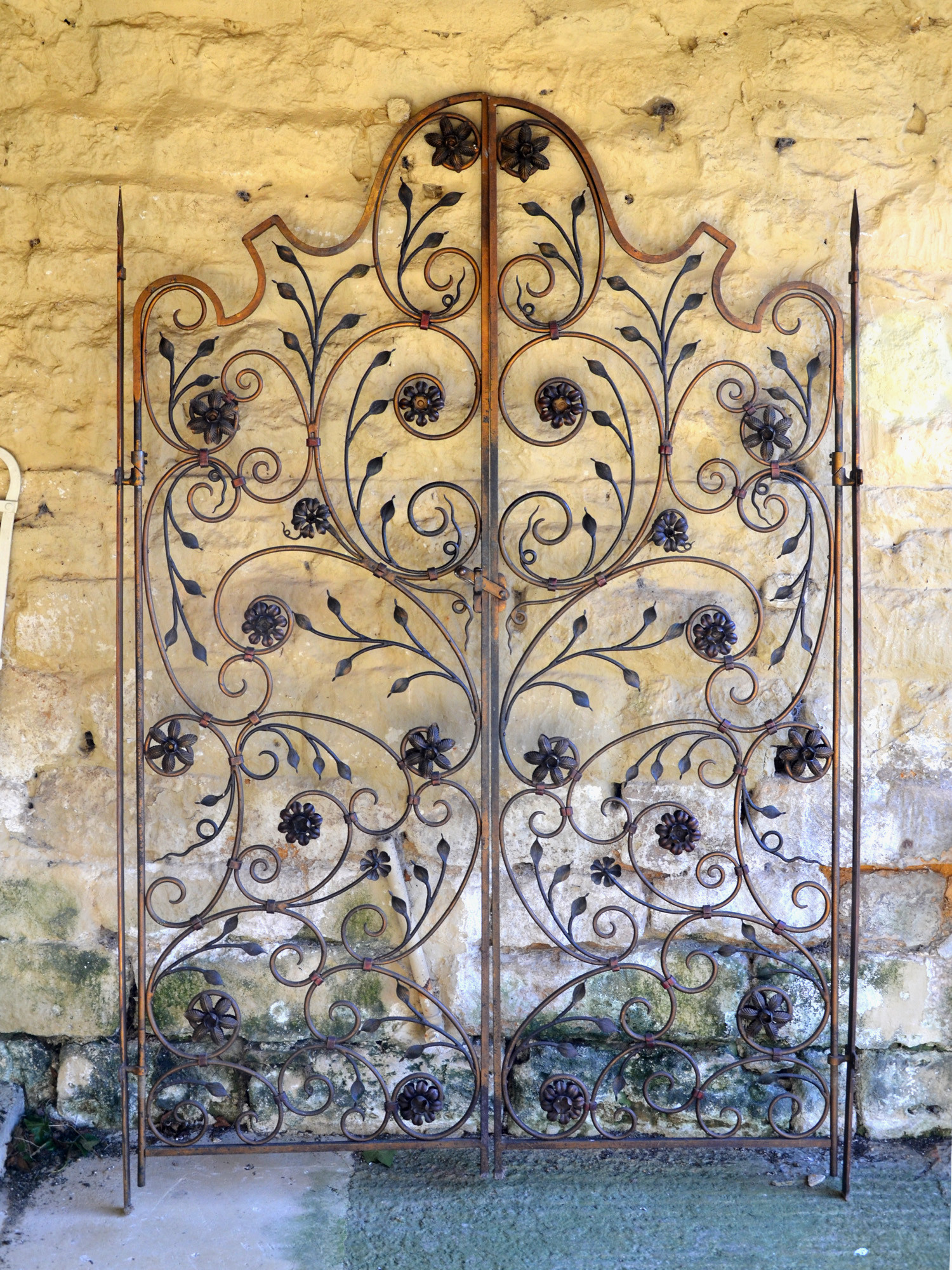 A pair of decorative ironwork gates