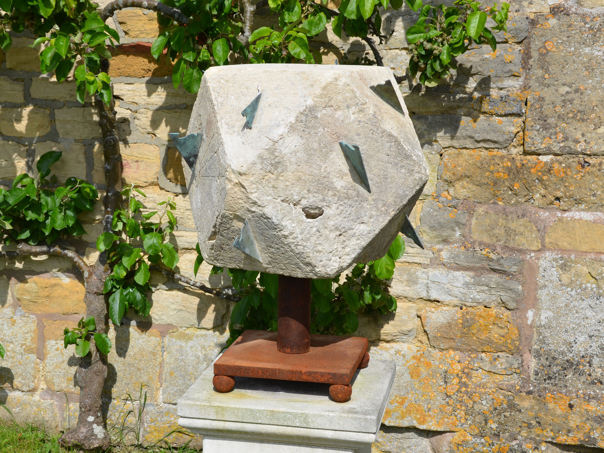 A large 18th century polyhedral limestone sundial
