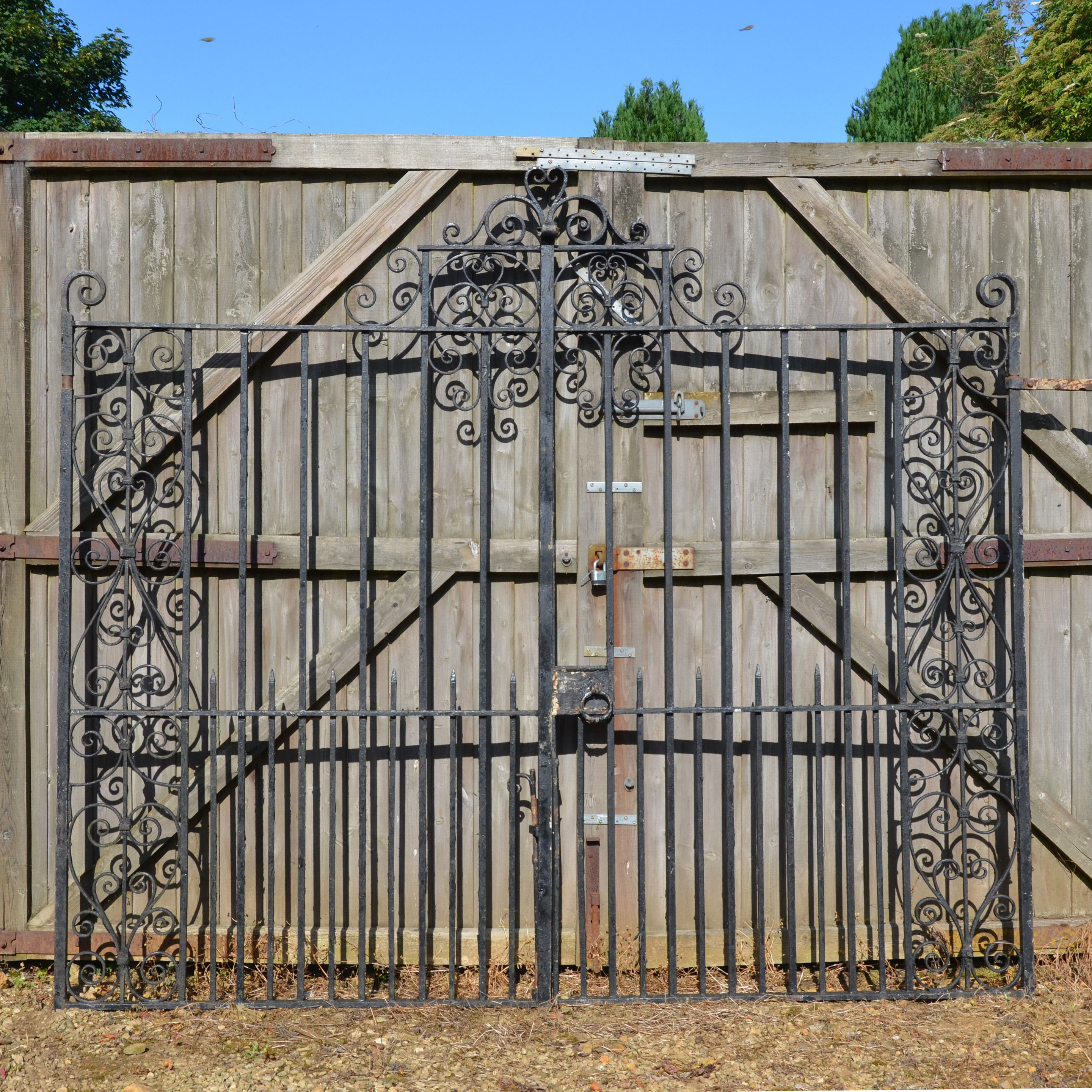 A pair of early 20th century wrought iron entrance gates