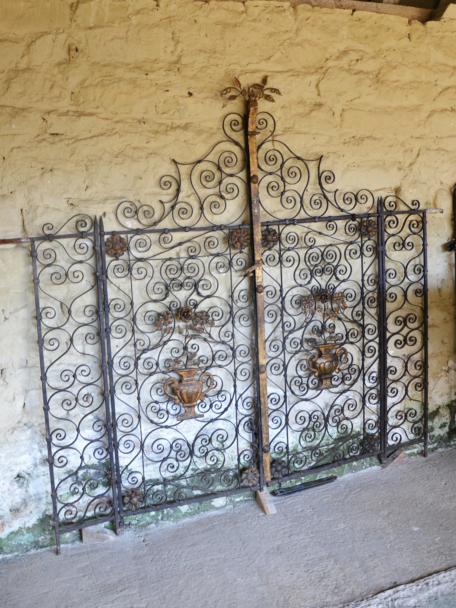 A pair of early 20th century Continental wrought iron and toll work garden gates