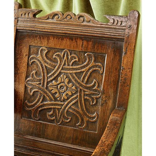 A Mid Century 17th Century Carved Oak Wainscot Chair