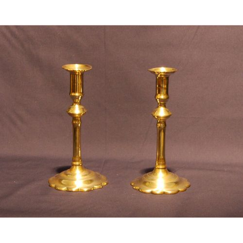 Pair of George II petal based Brass Candlesticks